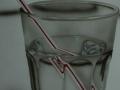 Wasserglas mit Strohhalm